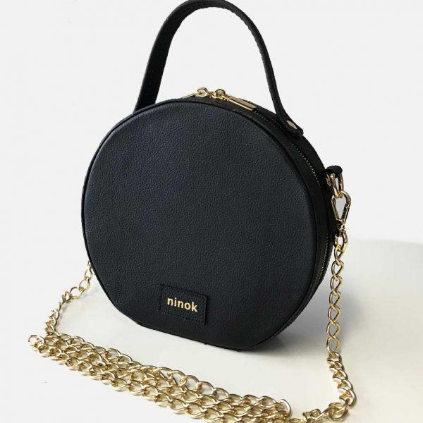 Circle Bag schwarz, runde Ledertasche Schultertasche mit Kette, Henkel und Reißverschluss.