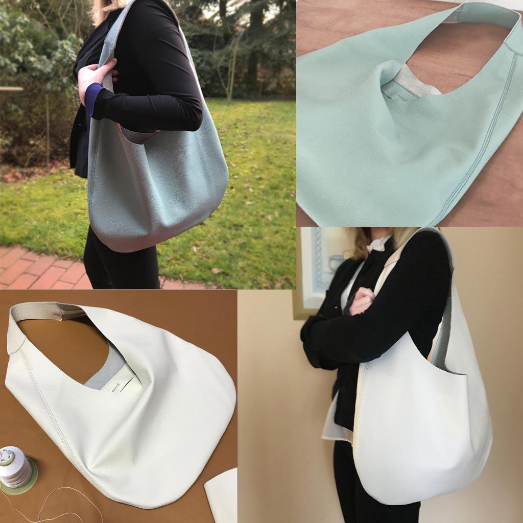 b45b16d8860bd Hobo Bag aus Leder in weiss und puderblau mit einem Henkel und Innentasche