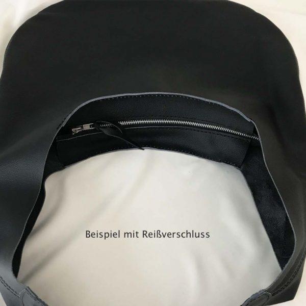 Hobo Ledertasche mit Reißverschluss, Beispielbild an schwarzer Tasche.