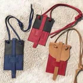 Handytasche aus Leder in schwarz/blau, schwarz/rot, cognac/rot für kleine und große Smartphones, Karten und Geld. Handytasche zum Umhängen, Crossbody und als Gürteltasche.